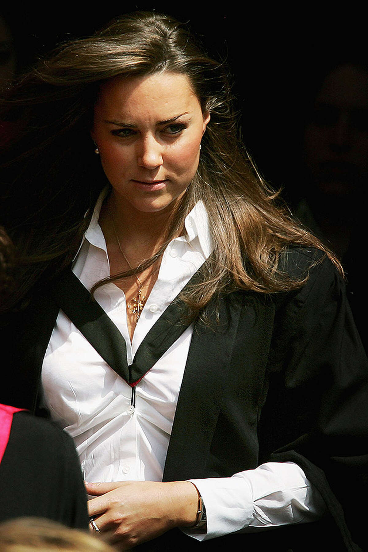 ST ANDREWS, UNITED KINGDOM - JUNE 23: Kate Middleton leaves Younger Hall after her graduation ceremony, June 23, 2005 in St Andrews, Scotland. The Prince, who earnt a 2:1 class Ma in Geography will lose the special protection set up to prevent the media from trailing him whilst he was in full-time education. William will be conducting his first solo official engagements in New Zealand over the next few months which will include ceremonies marking the anniversary of the end of World War II. (Photo by Bruno Vincent/Getty Images) *** Local Caption *** Kate Middleton