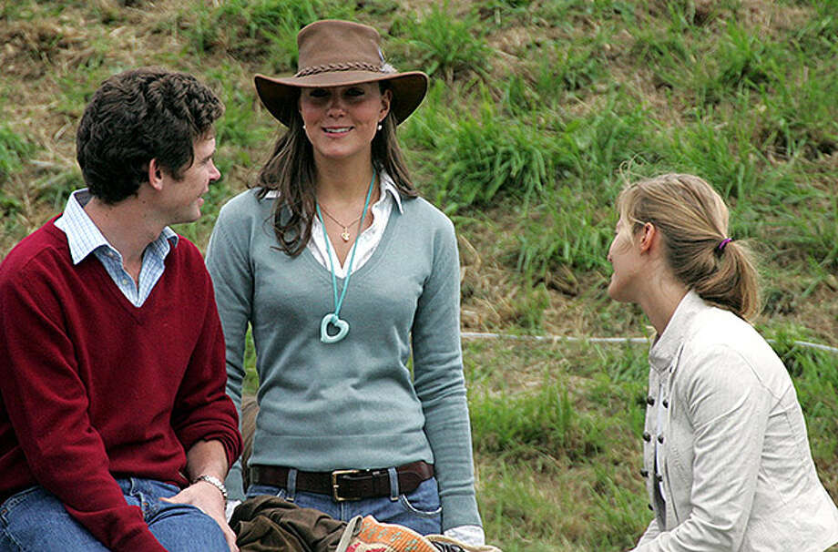 TETBURY, ENGLAND - AUGUST 6: Kate Middleton (C), girlfriend of Prince William chats with friends and companions in front of the main arena, on the second day of the Gatcombe Park Festival of British Eventing at Gatcombe Park, on August 6, 2005 near Tetbury, England. (Photo by Matt Cardy/Getty Images) Photo: Matt Cardy, Getty Images / 2005 Getty Images