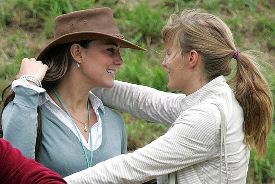 TETBURY, ENGLAND - AUGUST 6: Kate Middleton (L), girlfriend of Prince William hugs a friend in front of the main arena, on the second day of the Gatcombe Park Festival of British Eventing at Gatcombe Park, on August 6, 2005 near Tetbury, England. (Photo by Matt Cardy/Getty Images) Photo: Matt Cardy, Getty Images / 2005 Getty Images
