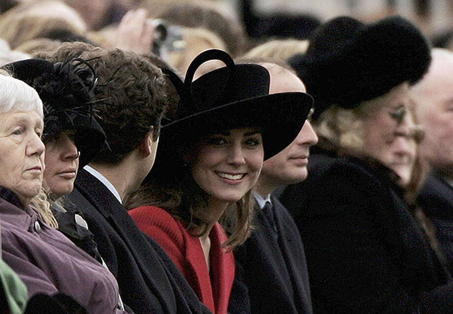 SANDHURST, ENGLAND - DECEMBER 15: HRH Prince William's girlfriend Kate Middleton (C) looks round while watching William take part in The Sovereign's Parade at The Royal Military Academy Sandhurst on December 15, 2006 in Sandhurst, England. There were 446 Officer Cadets in the parade of which 227 were passing out and 14 different countries armed forces were represented.  (Photo by Julian Herbert/Getty Images) Photo: Julian Herbert, Getty Images / 2006 Getty Images