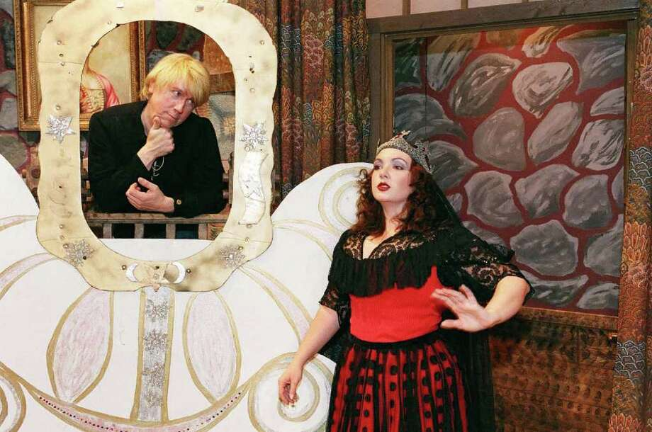 """Andrew Morris of Georgetown, who portrayed the dame Auntie Septic in the Town Players of New Canaan's panto """"Goldilocks"""" last December, appears this year as the Mirror as he ponders """"Mirror, mirror who's the fairest of them all?"""" posed by Queen Evilynn, played by Deborah Runestad of Norwalk. Photo: Contributed Photo / New Canaan News"""