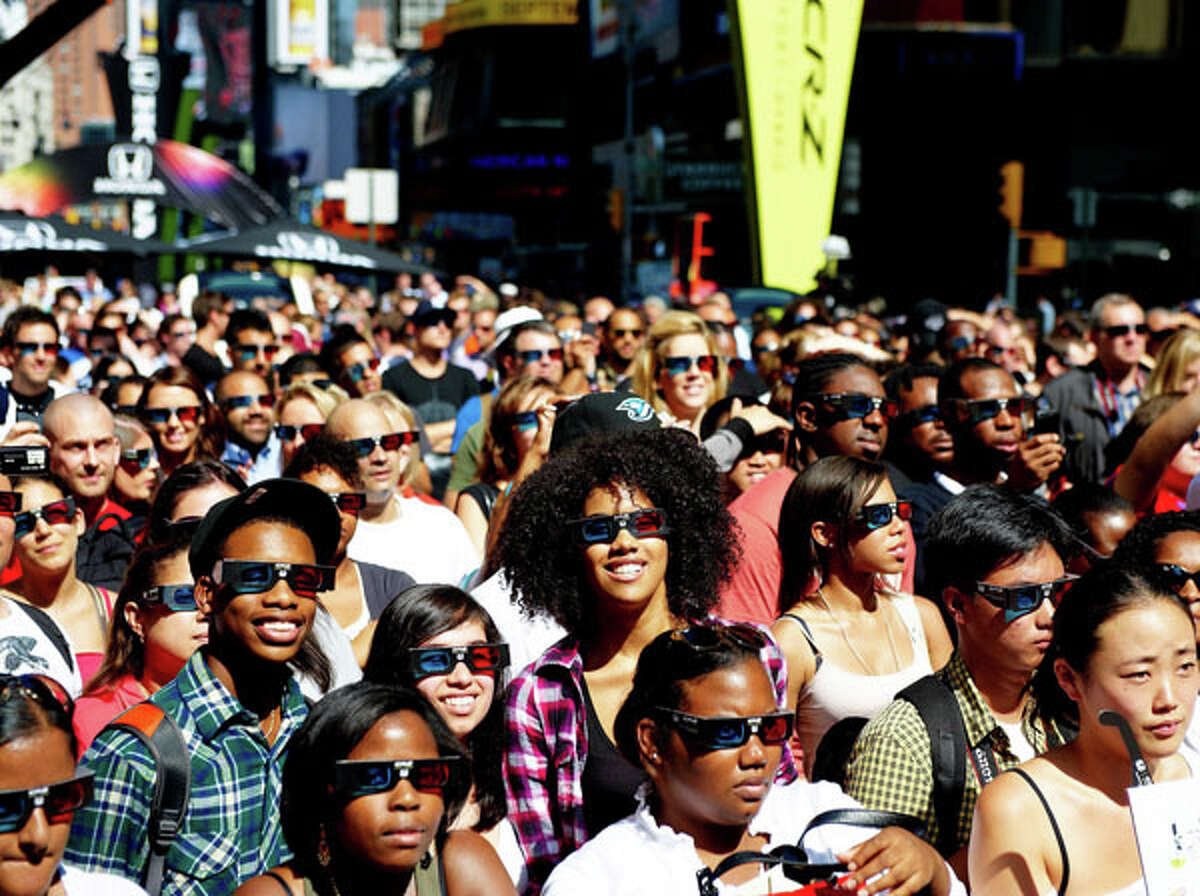 Fans wear 3-D glasses as they watch the rap trio N.E.R.D. perform during a 3-D concert in New York's Times Square. AP Photo/Honda, Phillip Angert