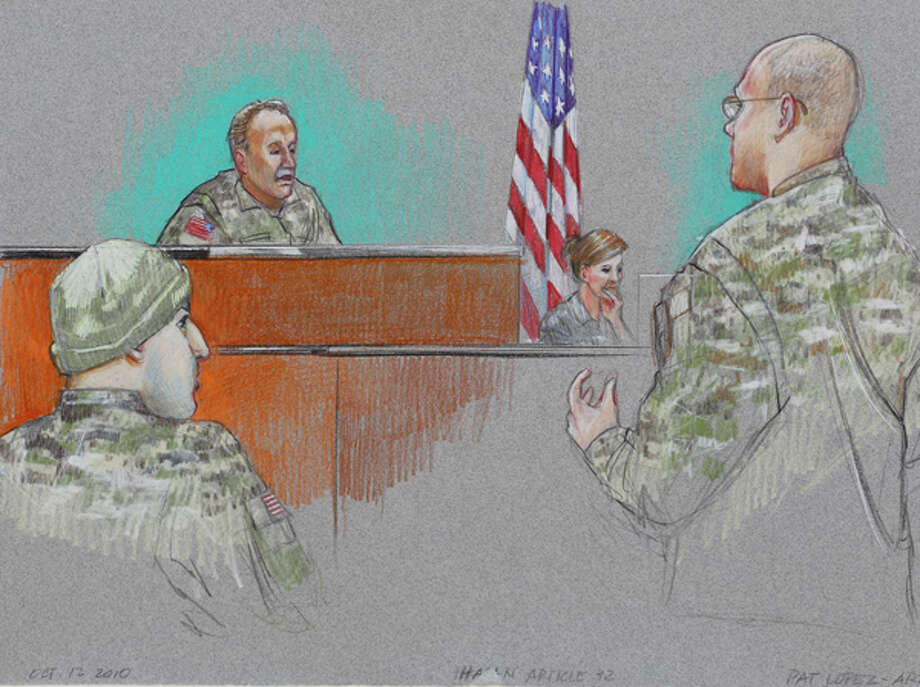 In this courtroom sketch, defense attorney Lt. Col. Kris Poppe, right, speaks to Investigating Officer Col. James L. Pohl, center, while Maj. Nidal Malik Hasan, left, listens during Hasan's Article 32 hearing inside the U.S. Magistrate court Tuesday in Fort Hood. Hasan, 40, is charged with premeditated murder and attempted premeditated murder in a Nov. 5 attack that killed 13 people and wounded 32 others in a processing center where soldiers were making final preparations to deploy. Unidentified woman, center right, is a court reporter. AP Photo/Pat Lopez / AP