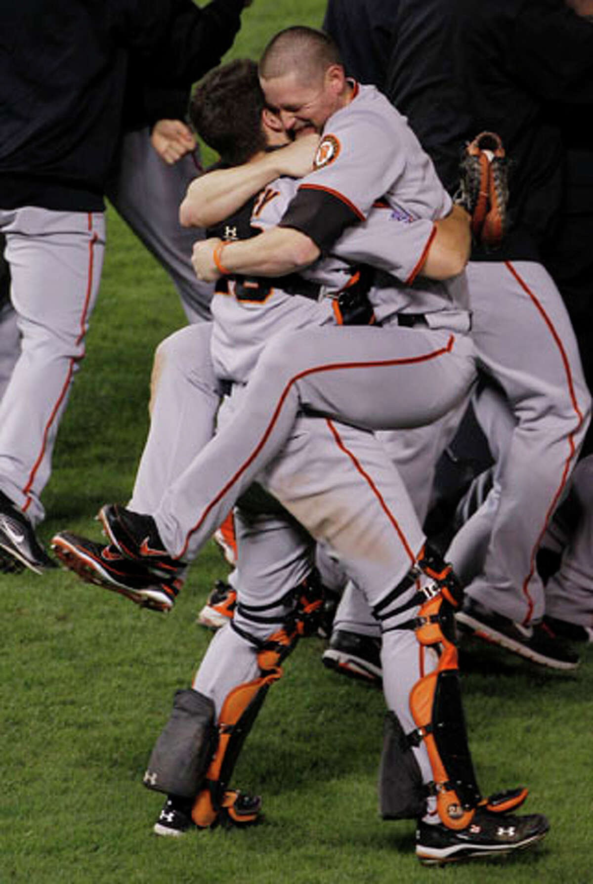 San Francisco Giants Aubrey Huff hugs with Buster Posey, left, after winning the World Series. AP Photo/Mark Humphrey