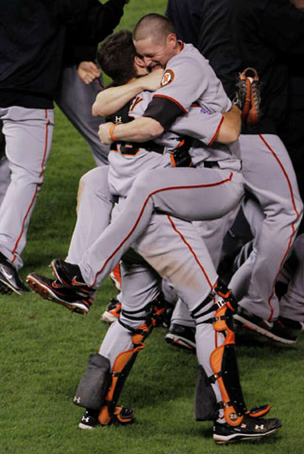 San Francisco Giants Aubrey Huff hugs with Buster Posey, left, after winning the World Series. AP Photo/Mark Humphrey / AP