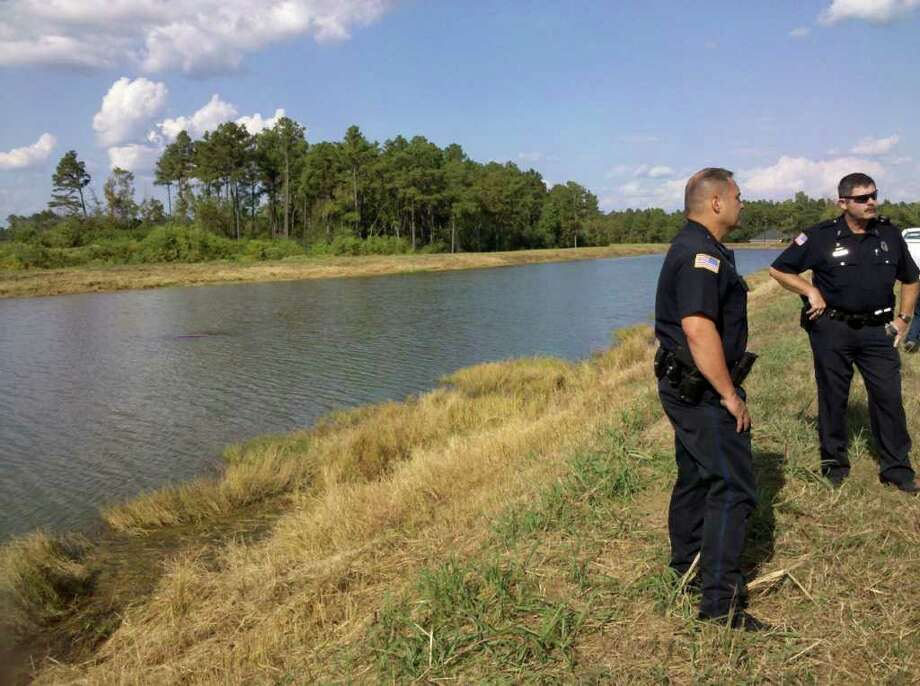 The Beaumont Police Department is organizing a dive team to retrieve a car from the canal near North Major Drive. Teresa Mioli/The Enterprise