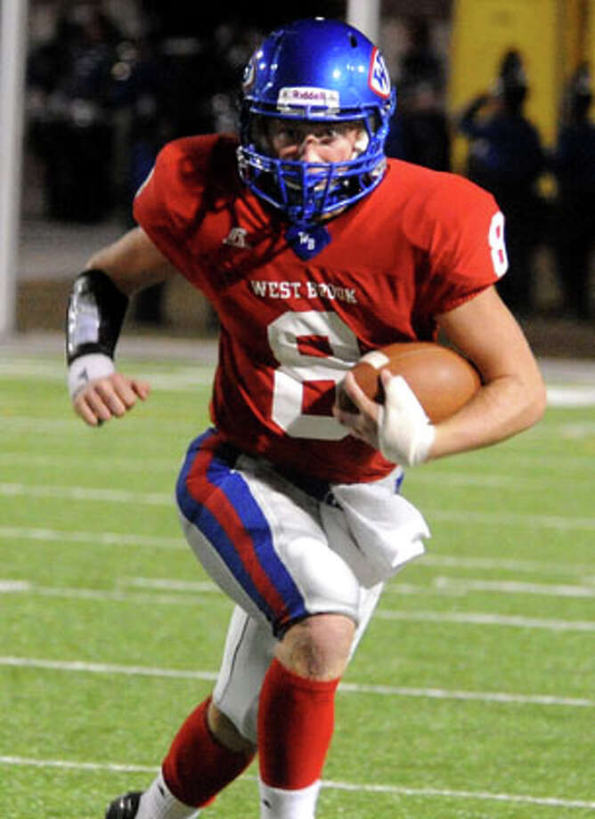 """West Brook's Joshua Stump runs for yardage during the game against Sterling at the Carrol A. """"Butch"""" Thomas Educational Support Center in Beaumont, Friday. Tammy McKinley/The Enterprise / Beaumont Enterprise"""