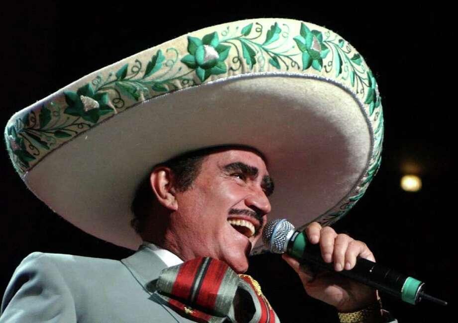 Vincente Fernandez and Paquita La Del Barrio perform Saturday at 8 p.m. at the Toyota Center in Houston. (AP Photo/ (Louis Lanzano) / AP