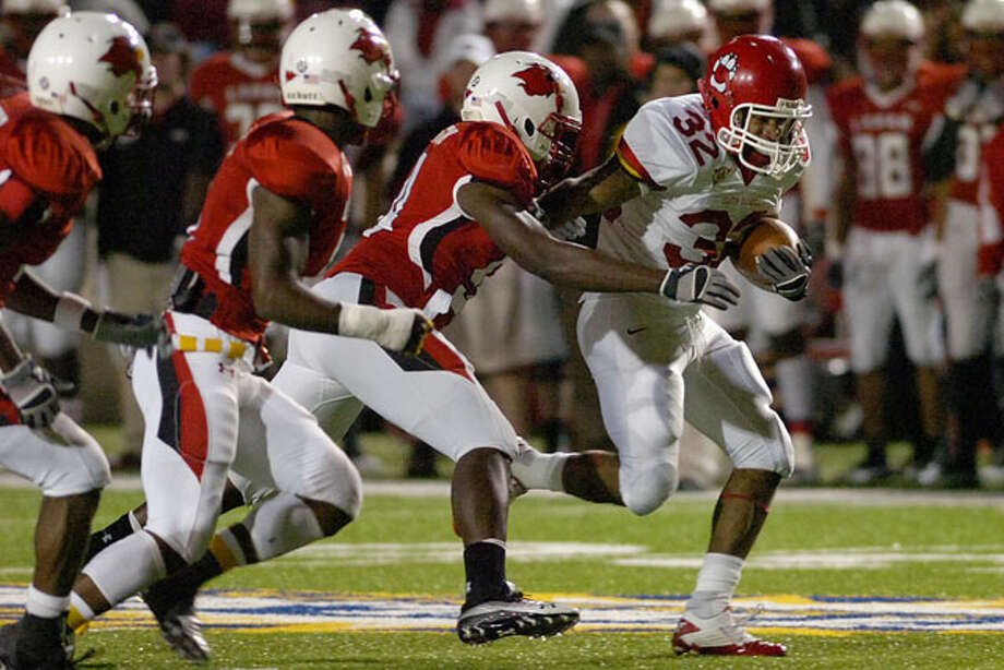 South Dakota running back Marcus Sims tries to outrun the Lamar defense in the first half of their game at Provost Umphrey Stadium in Beaumont, Texas. Saturday, November 13, 2010.  Valentino  Mauricio/The Enterprise / Beaumont