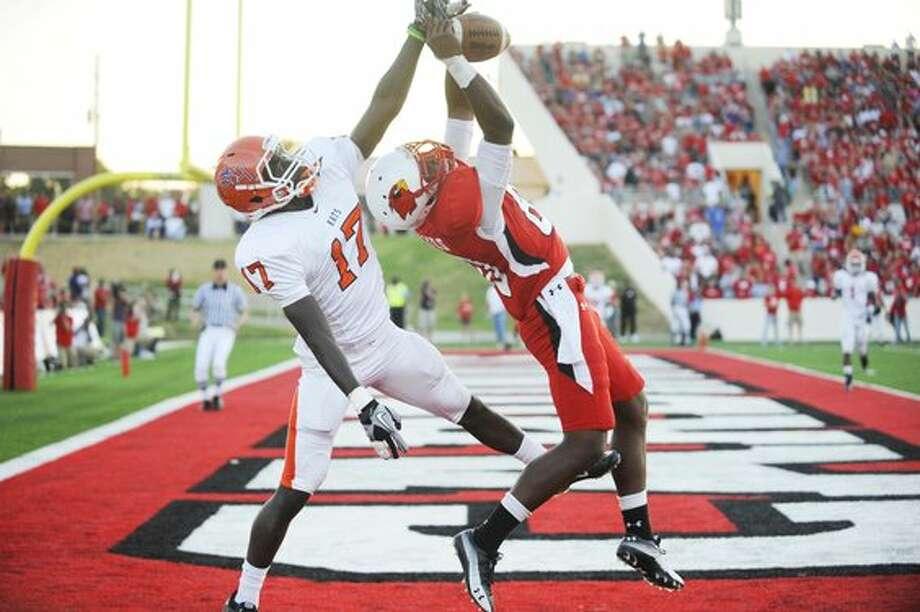 Lamar wide receiver J.J. Hayes, right, battles for a reception with Sam Houston State's Bookie Sneed at Provost Umphrey Stadium in the first half on Saturday, October 2, 2010.  Valentino Mauricio/The Enterprise / Beaumont