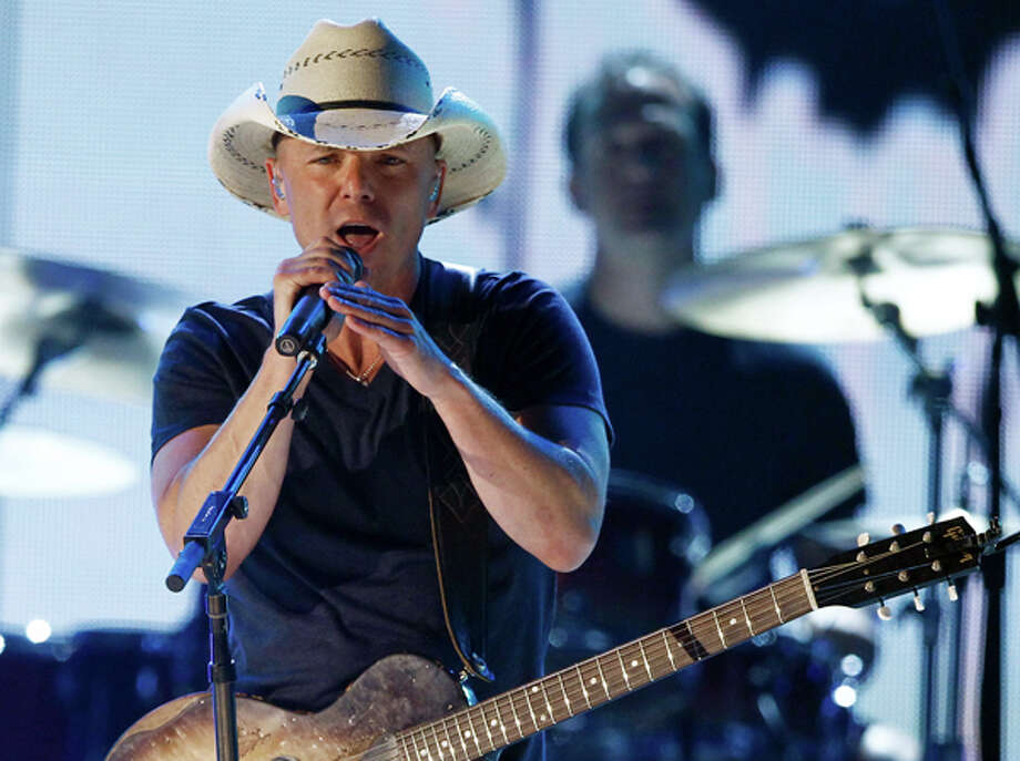 Kenny Chesney performs April 18 at the 45th Annual Academy of Country Music Awards in Las Vegas. Chesney will co-headline nine concerts with the Zac Brown Band next year. AP Photo/Matt Sayles / AP