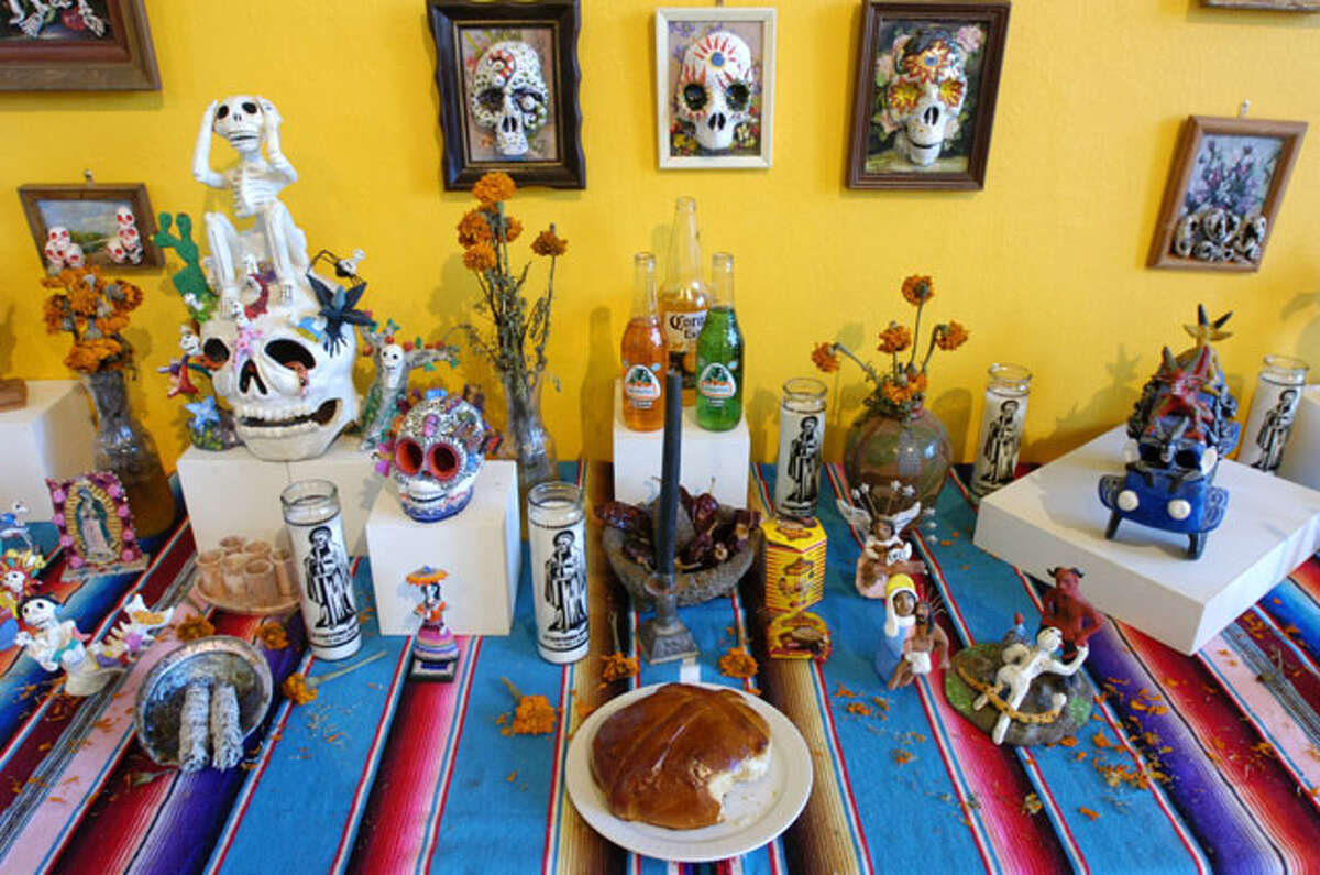 At the Art Museum of Southeast Texas, an ofrendas (offerings) table was on display during a Dia de los Muertos (Day of the Dead) event on Saturday. Each year the museum, through exhibitions and hands on art projects, teaches children about the Mexican holiday and its significance in the culture. October 30, 2010. Valentino Mauricio/The Enterprise