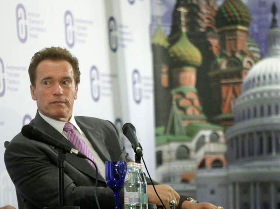 California's Gov. Arnold Schwarzenegger looks on during a meeting with businessmen in Moscow, Russia, on Monday. Schwarzenegger is leading a delegation of Silicon Valley business leaders and venture capitalists on a trip intended to help connect them with Russian counterparts. AP Photo/Mikhail Metzel / AP