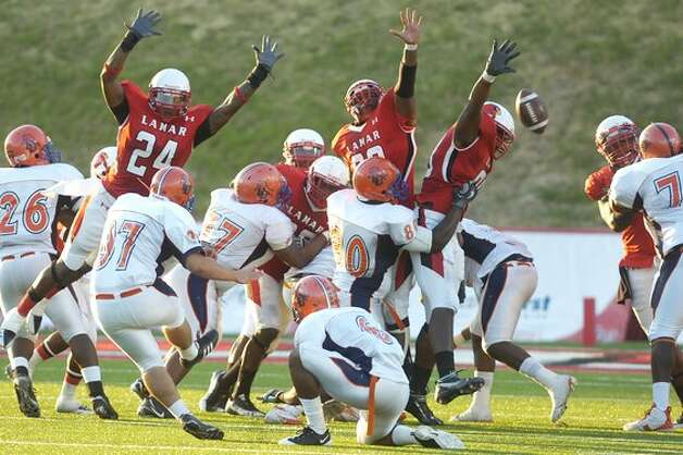 The Lamar defense gets the  block on a field goal attempt by Langston University during the first half at Provost Umphrey Stadium.  Valentino Mauricio/The Enterprise / Beaumont