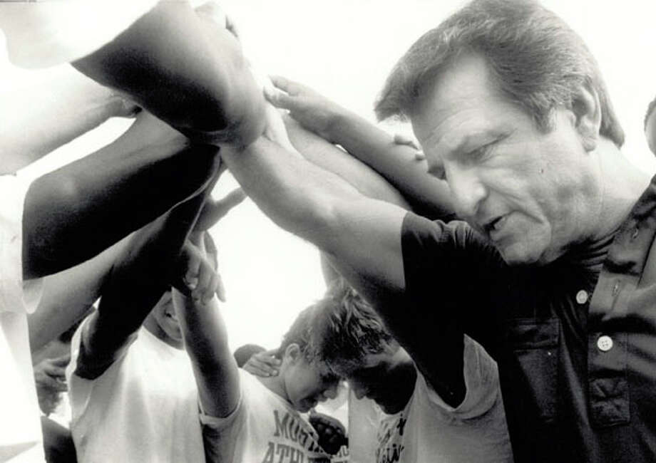 West Orange-Stark High School head football coach Dan Hooks and his players meet after the opening practice of the 1986 season. Enterprise file photo