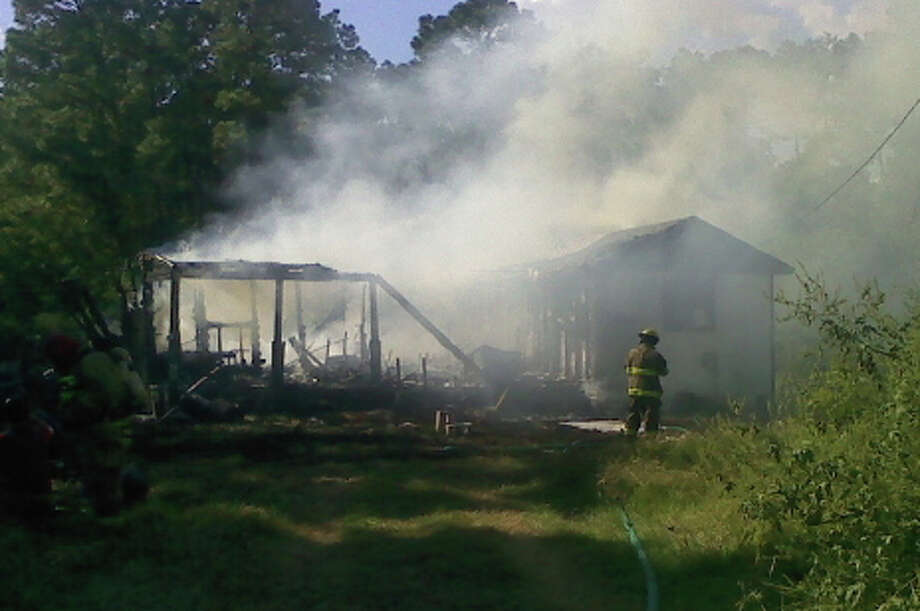 A house in the 6700 block of north Texas 62 was fully engulfed when firefighters arrived Sunday, Oct. 10. Photo courtesy of the Mauriceville Volunteer Fire Department