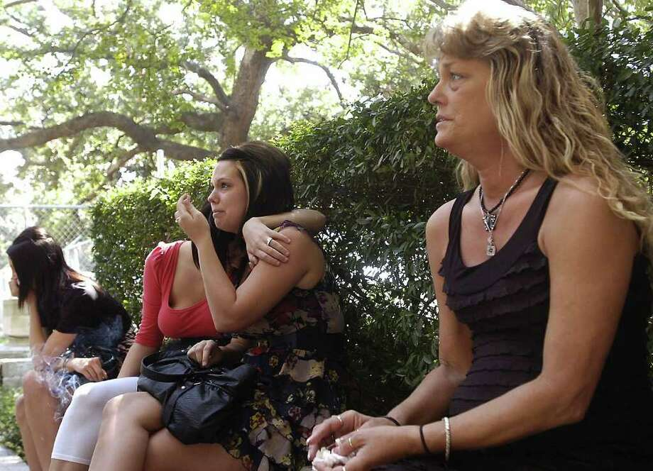 """Waiting outside the courthouse for the jury to reconvene to hear testimony regarding punishment for the now guilty Joseph """"Jimmy"""" Desormeaux, Summer Bourque's mother, Stacy Bourque, right, talks about missing her daughter.  Summer's sister Jaemie Dominguez, middle and friend Stephanie Arens, left, comfort each other while listening to the mother. Dave Ryan/The Enterprise / Beaumont"""