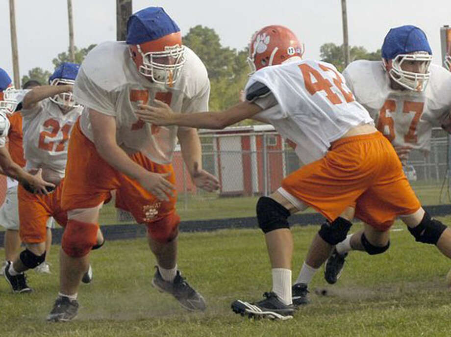 At 6-foot-5, 300 pounds, Orangefield offensive lineman Corey Cargill, left, has always been a big kid. Cargill decided to change to change some things in his senior year. He put in the work to get in better shape and now colleges are looking at him. Dave Ryan/The Enterprise / Beaumont