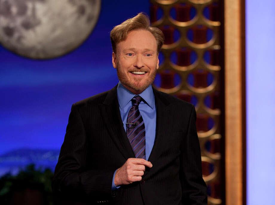 "Conan O'Brien performs during the debut of his new TBS show, ""Conan,"" on Monday. AP Photo/TBS / TBS"
