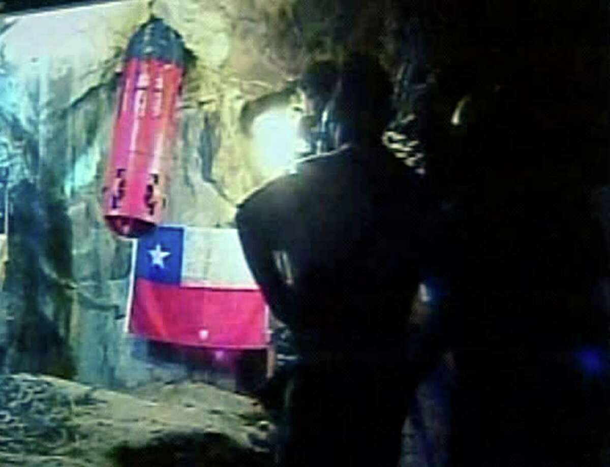 In this screen grab taken from video, Florencio Avalos, the first miner to be rescued, inside capsule at left, begins journey up the escape shaft to outside world Tuesday, Oct. 12, 2010 at San Jose Mine near Copiapo, Chile. (AP Photo)