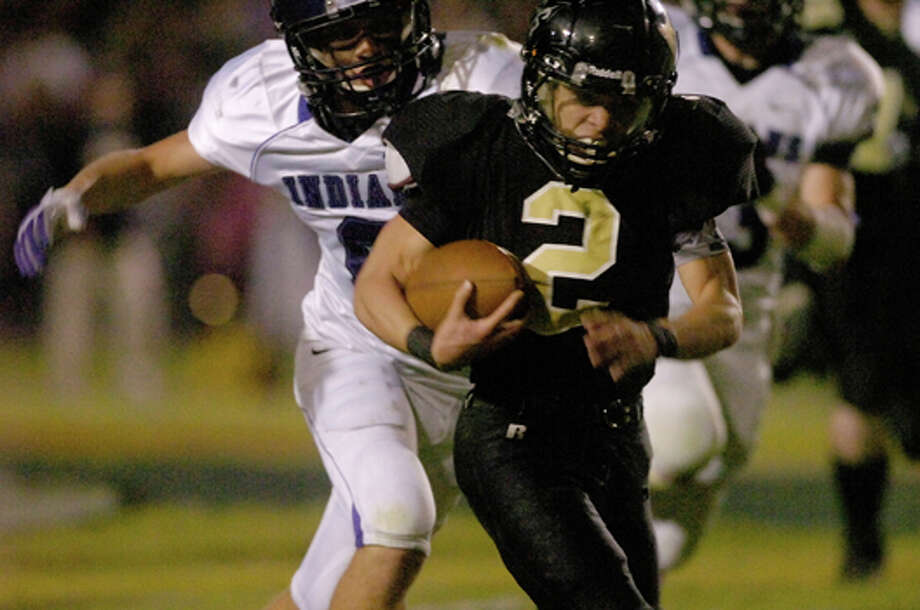 PN-G defensive back Chase Romero, top,  gets the tackle on Vidor running back David Bolinger, center, and sets up a PN-G fumble recovery in the first half of their matchup at Vidor on Friday, October 29 2010. Valentino Mauricio/The Enterprise / Beaumont