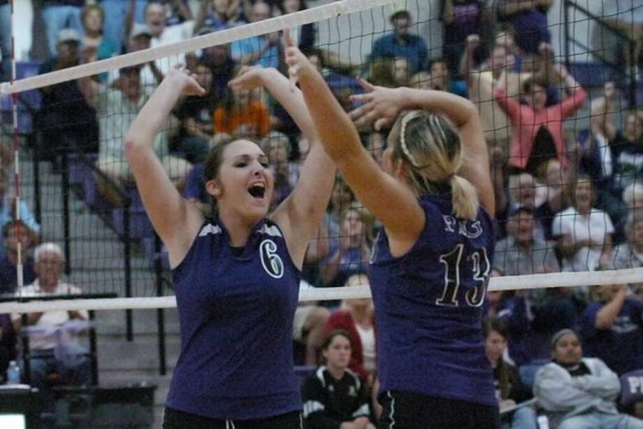 Port Neches-Groves volleyball players, Kasie Ware, left, and Kirsten Satterwhite celebrate a point  against Nederland on Tuesday. Valentino Mauricio/ The Enterprise / Beaumont