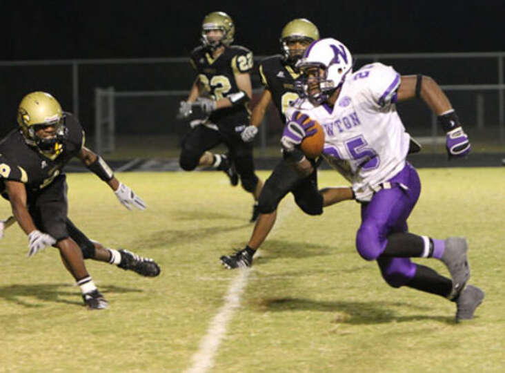 Newton's Jeremy Jackson breaks towards the end zone during the final moments of Newton's victory ove