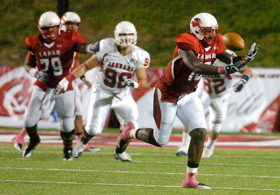 Lamar tight end Billy Chavis tries to hold onto a pass in the first half against South Alabama on Saturday at Provost Umphrey Stadium.  October 16, 2010. Valentino Mauricio/The Enterprise / Beaumont