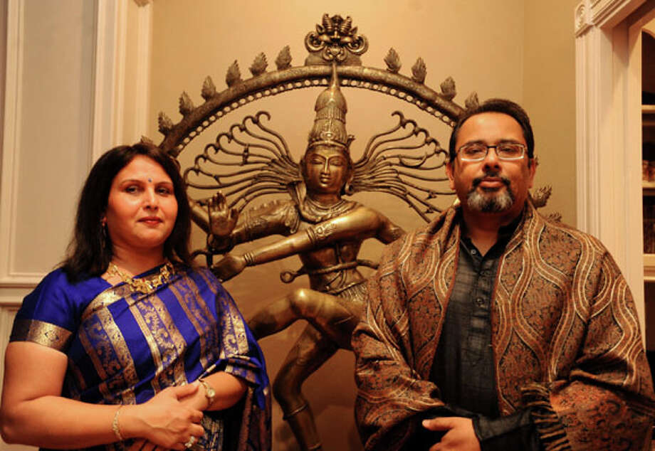 Dr. Geeta Singh and Dr. Saurabh Singh pose for a portrait at their home in Beaumont, Tuesday. Dr. Saurabh Singh is the cultural director of the India Association of Southeast Texas. Tammy McKinley/The Enterprise / Beaumont