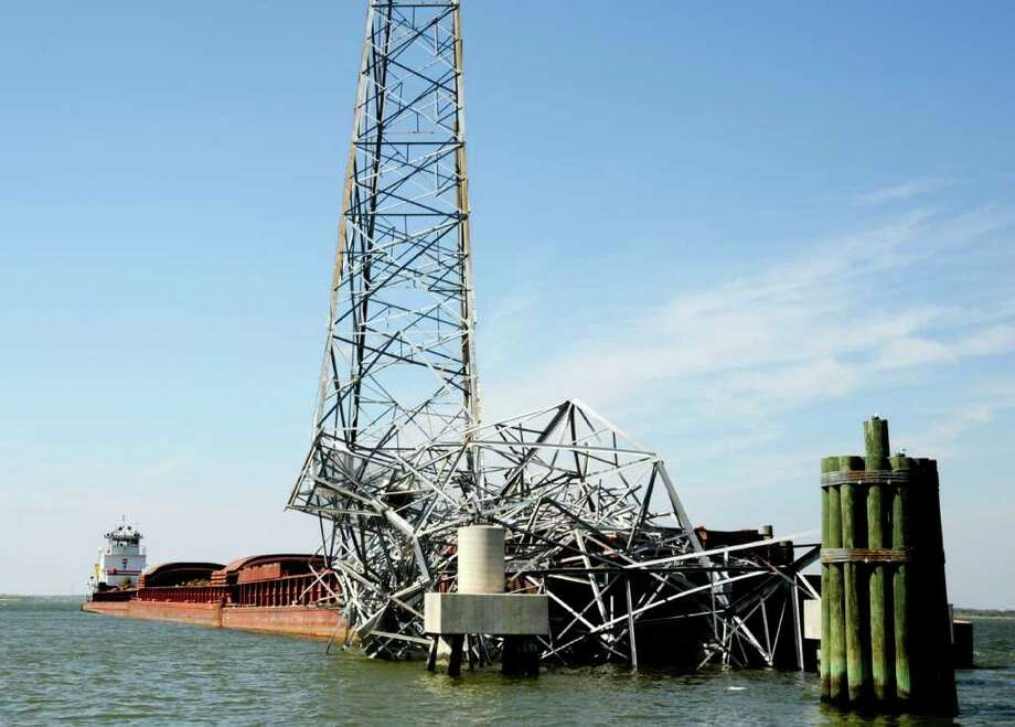 Damage to a high voltage electrical transmission line tower in Baytown is shown after a barge collided into it early Sunday morning in the Houston ship channel. The U.S. Coast Guard says much of the Houston Ship Channel will be closed to marine traffic until at least Tuesday night. Petty Officer 2nd Class Prentice Danner/U.S. Coast Guard