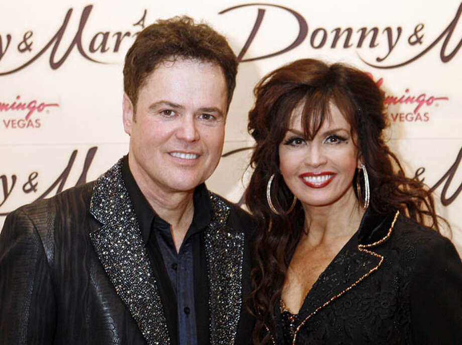 """Donny Osmond, left, and Marie Osmond pose together after a performance at the Flamingo Hotel-Casino in Las Vegas on April 2, 2009. The siblings will star in """"Donny & Marie ? A Broadway Christmas"""" at the Marriott Marquis Theatre starting Dec. 9. AP Photo/Louie Traub, File / AP2009"""