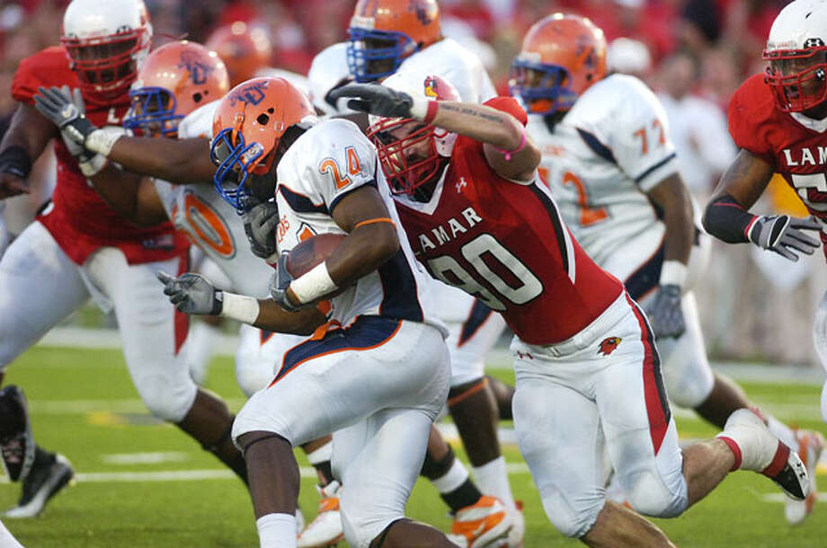 Lamar defensive tackle Mark Murrill, right, gets the stop on Langston University running back Ricky Shearin (24) during the first half at Provost Umphrey Stadium. Saturday, October 9, 2010 Valentino Mauricio/The Enterprise / Beaumont
