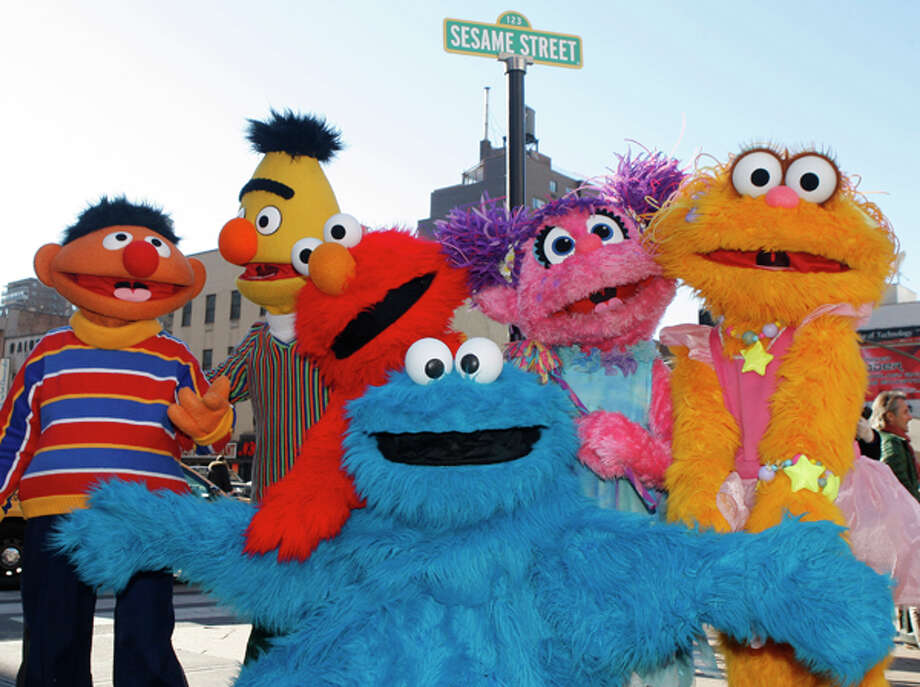 """From left: Ernie, Bert, Elmo, Cookie Monster (foreground), Abby Cadabby and Zoe are part of """"Sesame Street Live!"""", which will be at Ford Arena through Sunday. AP Photo/Kathy Willens / AP"""