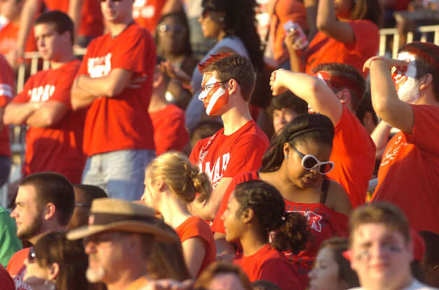 A Lamar fan, center,  not just another face in the crowd, shows his Cardinals pride during the first half against Langston University on Saturday, October 9, 2010. Valentino Mauricio/The Enterprise / Beaumont