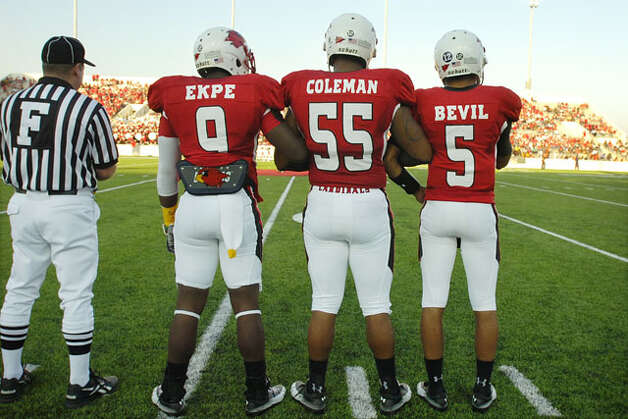 Lamar Cardinals football players, Johnathan Ekpe, left, Jocody Coleman, and Andre Bevil prepare to meet the Langston University co-captains for the coin toss before their homecoming matchup at Provost Umphrey Stadium. Saturday, October 9, 2010. Valentino Mauricio/The Enterprise / Beaumont