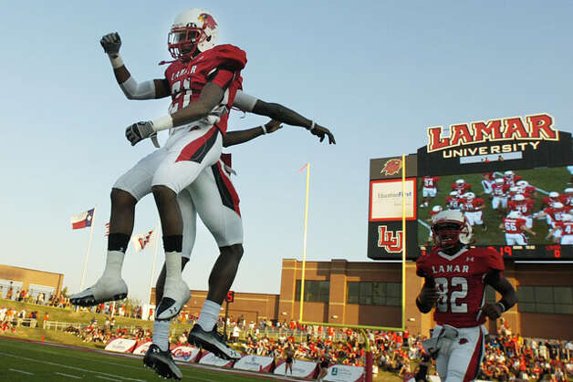 The Lamar Cardinals take the field in their homecoming matchup against Langston University at Provost Umphrey Stadium. Saturday, October 9, 2010. Valentino Mauricio/The Enterprise / Beaumont