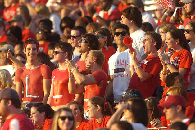 Lamar fans cheer the Cardinals on in the first half against Langston University during their homecoming matchup on Saturday, October 9, 2010. Valentino Mauricio/The Enterprise / Beaumont