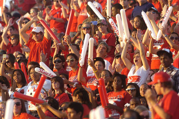 Lamar fans celebrate the Cardinals 47-yard touchdown reception by wide receiver Marcus Jackson during the first half against Langston University on Saturday, October 9, 2010. Valentino Mauricio/The Enterprise / Beaumont