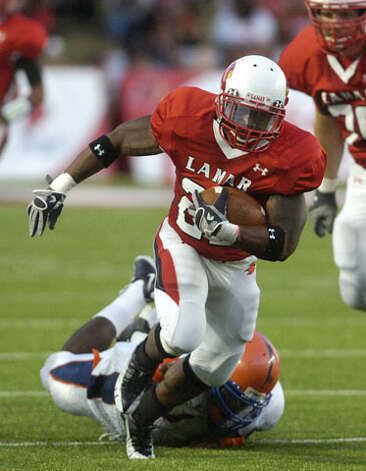 Lamar running back Octavious Logan keeps his balance on run up the middle for a gain in the first half against Langston University at Provost Umphrey Stadium. Saturday, October 9, 2010 Valentino Mauricio/The Enterprise / Beaumont