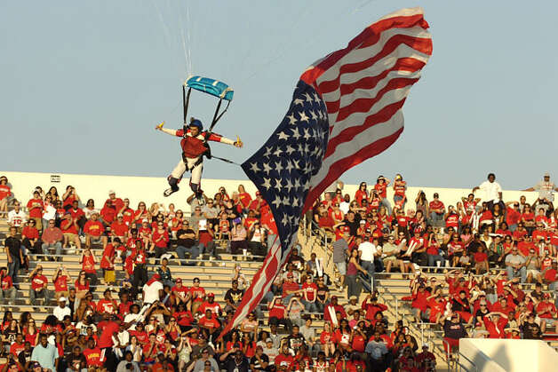 A member of Ground Rush Sky Diving prepares to land at Provost Umphrey Stadium with the flag of the United States during a pre-game show before the Cardinals homecoming matchup against Langston University Saturday, October 9, 2010 Valentino Mauricio/The Enterprise / Beaumont