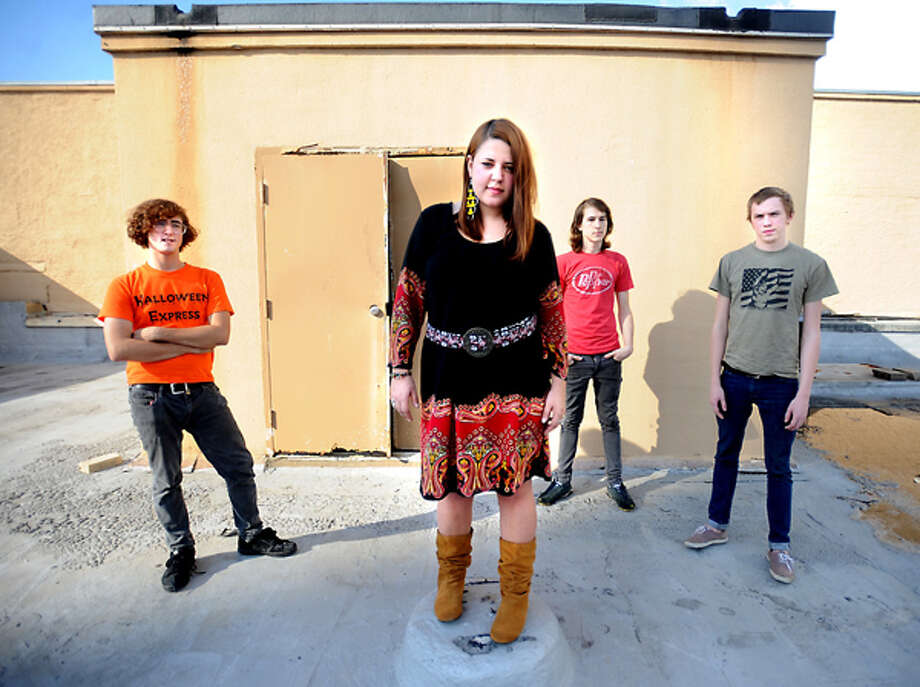 Tyer Thibeaux, Jenny Carson, Kurt Scoggins, and Ben Jennings of Jenny and the Reincarnation pose for a portrait downtown Beaumont, Tuesday. Tammy McKinley/The Enterprise / Beaumont