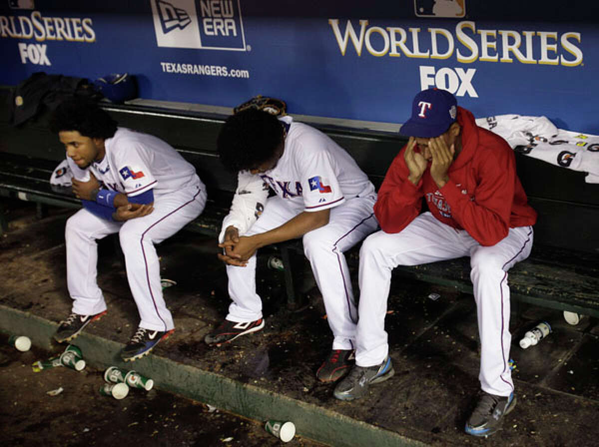 Texas Rangers sit in the dugout after the San Francisco Giants won the World Series in Game 5 of baseball's World Series Monday. AP Photo/David J. Phillip