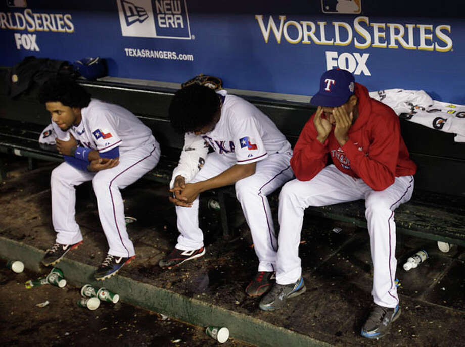 Texas Rangers sit in the dugout after the San Francisco Giants won the World Series in Game 5 of baseball's World Series Monday. AP Photo/David J. Phillip / Copyright: AP