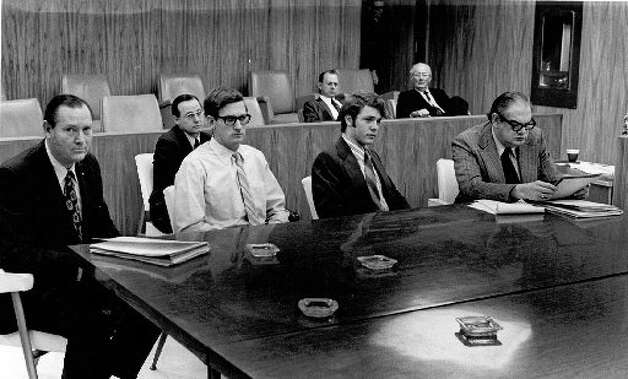 In this file photo taken at the pre-trial hearing in February 1972, the two suspects, Dennis Ray Anderson and Fred Young sit between their defense counsel in 88th District Judge H. A. Coe's courtroom in Kountze. Charles Easterling of Houston is on the left, and Joe Goodwin of Beaumont is on the right. Enterprise File Photo