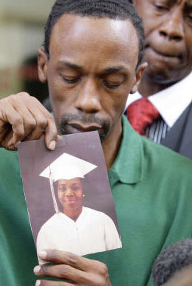 Michael Anthony Green holds a photo earlier this year of his mother, Mary Ann Strait, who died while he was in prison. Melissa Phillip/Houston Chronicle