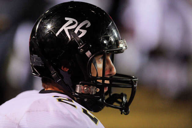 Vidor running back Hank Madden and his teammates continue to wear the RG initials on their helmets in honor of fallen West Orange-Stark quarterback Reggie Garrett. Friday, October 1, 2010 Valentino Mauricio/The Enterprise
