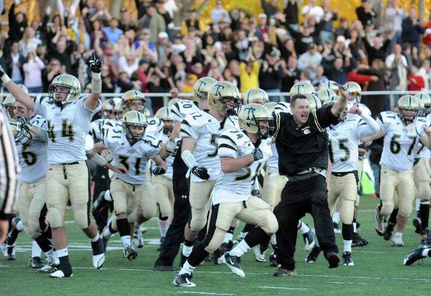 Trumbull celebrates their win over Staples 15-13, during football action in Westport, Conn. on Saturday November 13, 2010.