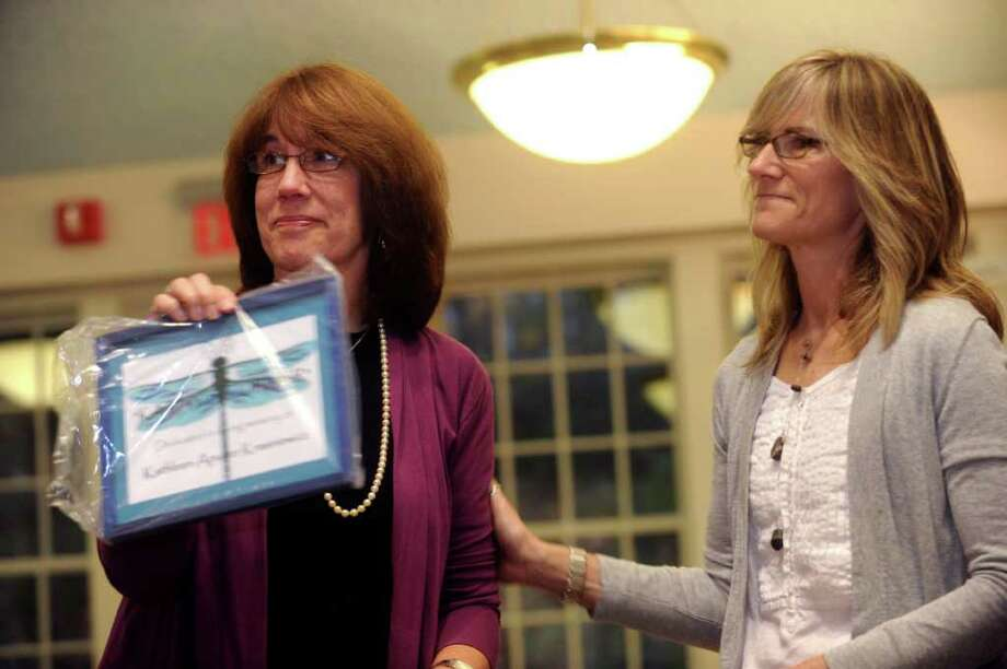 """Leigh Barbour, of Pittsford, Vt., left, and her sister Paige Davis, of Greenwich, admired the plaque that will hang in """"Kathy's Corner"""" in honor of Kathleen Krasniewicz, on Tuesday, Nov. 16, 2010. The sisters were friends with Kathleen Krasniewicz. Photo: Helen Neafsey / Greenwich Time"""