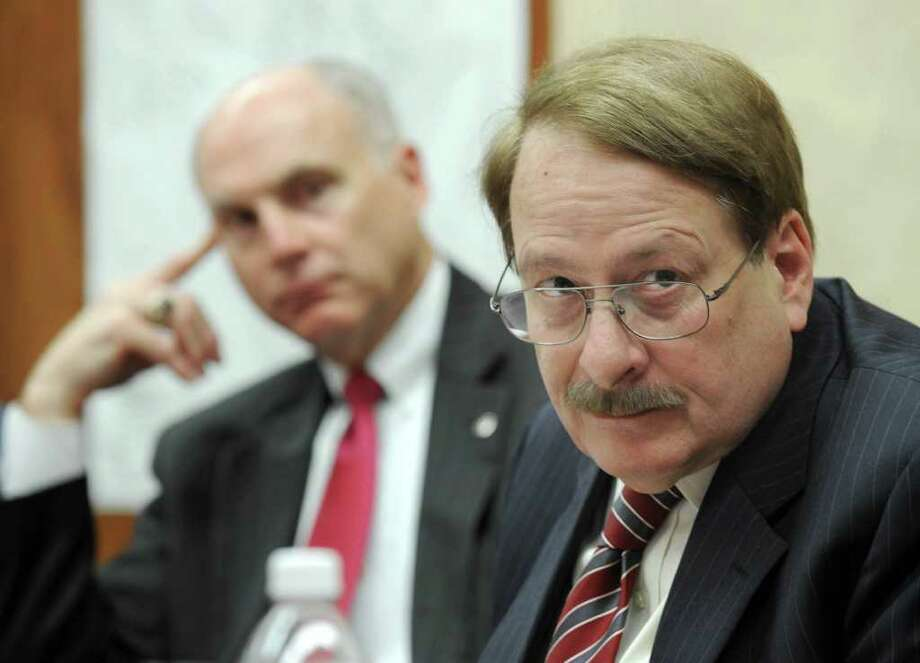 John Kline, left, chairman of the Main Street Renaissance Task Force, listens to Danbury planning director Dennis Elpern address a meeting of the task force at City Hall Tuesday afternoon, Nov. 16, 2010. Photo: Carol Kaliff / The News-Times