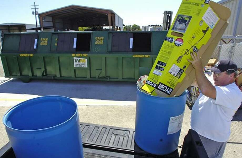 Danny Willis, a Beaumont resident, made a stop Monday morning at the Waste Management Recycle America Center to drop off a load of recyclable materials. Waste Management will begin it's subscription based recycling service, scheduled to start November 1, 2010, in targeted areas of Beaumont.   The service will cost $10 per month and will pick up curbside recycled materials once every other week.  Dave Ryan/The Enterprise / Beaumont